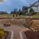 Retaining Wall, Exterior Lighting, Outdoor Fireplace, and custom steps