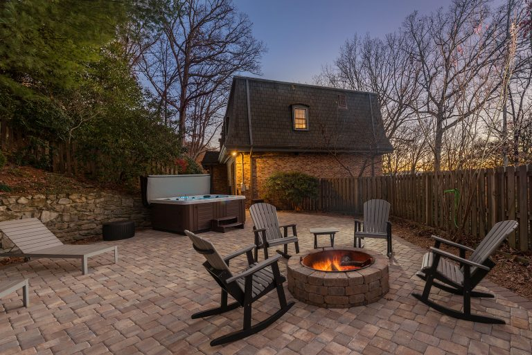 Paver Patio and Fireplace with rocking chairs and hot tub