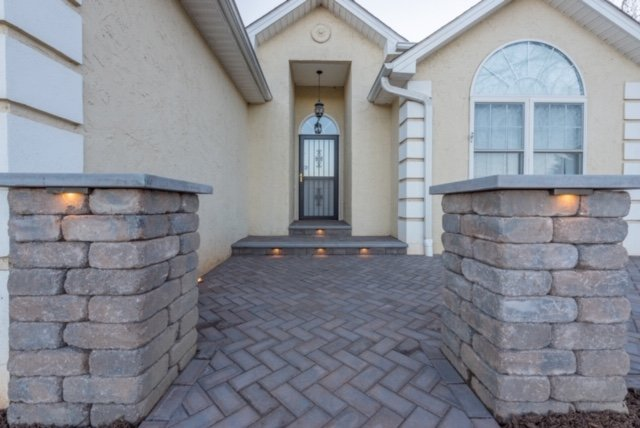 Pillars and Paver Patio with Landscape Lighting